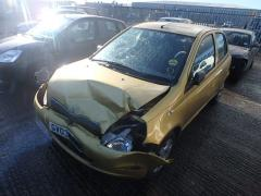 GOLDEN TOYOTA YARIS.JPG